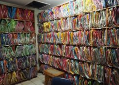 Hundreds of colorful medical record folders crammed into bookcases.
