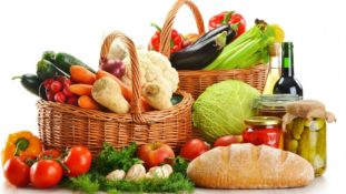 Image of baskets overflowing with vegetables and other healthy foods.