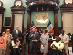 NYC council members presenting representatives of CIDNY with a proclamation.