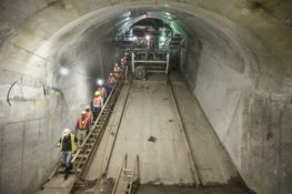 Image of workers inside subway tunnel.